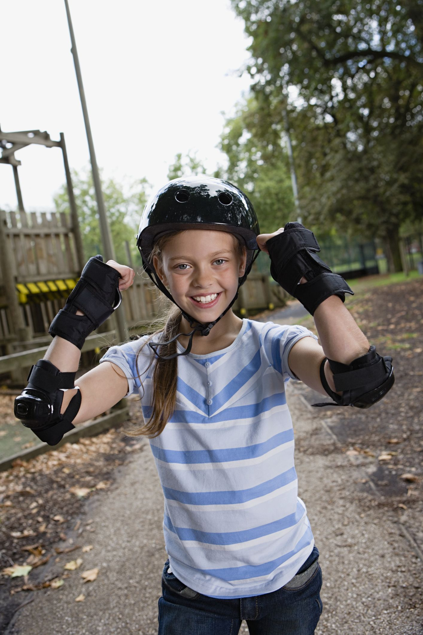 Skateboarder with protective gear